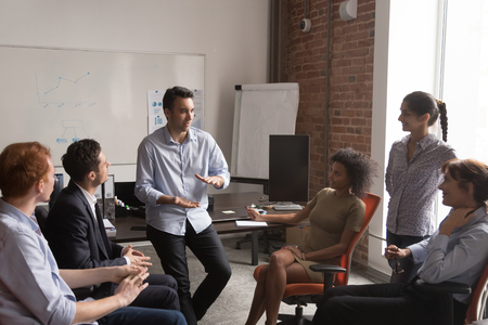 Photo for Diverse employees brainstorm share ideas at casual office meeting in coworking workspace, multiracial colleagues talk discuss projects together cooperating at informal briefing. Collaboration concept - Royalty Free Image