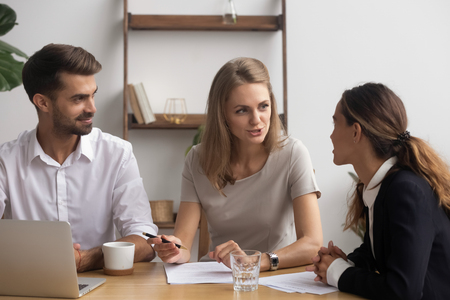 Photo for Satisfied professional company staff negotiating sitting together in office feeling good. Businesswomen businessman take break having informal talk discussing project sharing ideas finding solution - Royalty Free Image