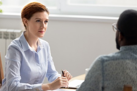 Photo for Business owner boss interviewing male black job candidate in office. Female executive manager attentively listening having good first impression. Human resources management, workforce search concept - Royalty Free Image