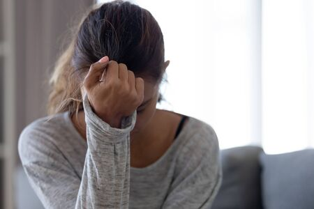 Foto de Depressed upset young woman feeling hurt sad stressed troubled with unwanted pregnancy, regret mistake abortion, having headache or drug addiction, suffer from grief dramatic bad problem concept - Imagen libre de derechos