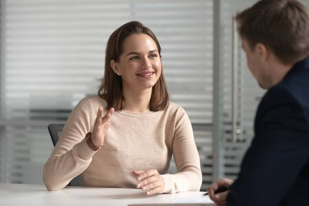 Photo pour Interested hr male manager or boss holding job interview with young female candidate. Financial advisor, lawyer, real estate agent, bank manager listening to clients wishes or needs at company office. - image libre de droit