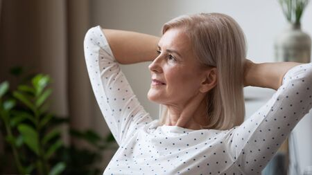 Photo for Dreamy mature woman relaxing leaning back close up, thinking about good future alone at home, older female stretching resting with hands behind head, looking in distance, enjoying weekend, free time - Royalty Free Image
