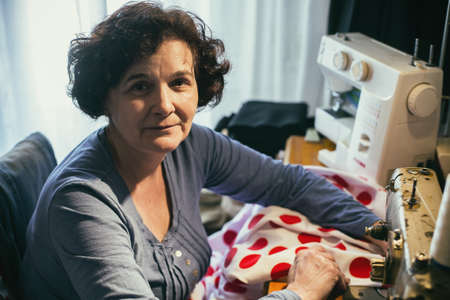 Photo for Middle aged woman sewing - Royalty Free Image
