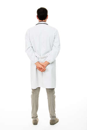 Photo for Full length backside view of a male doctor with hands behind his back - Royalty Free Image