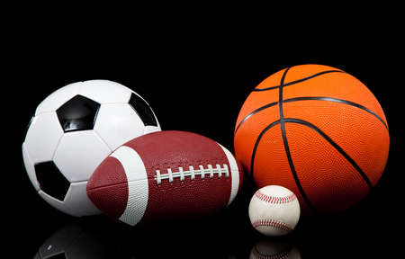 Multi sports balls on a black background