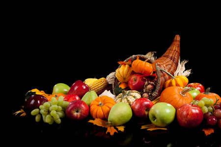 Photo for fall arrangement of fruits and vegetables in a cornucopia on a black background - Royalty Free Image