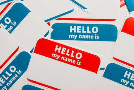Photo for A stack of blue and red  Hello, my name is  name tags or badges - Royalty Free Image