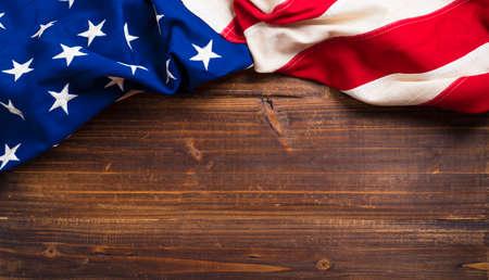 Foto de An old american flag on a antique wooden platform with copy space - Imagen libre de derechos