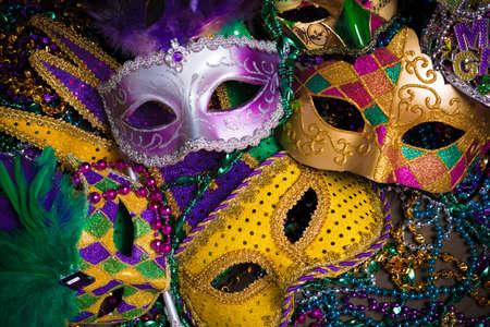 Foto de A group of venetian, mardi gras mask or disguise on a dark background - Imagen libre de derechos