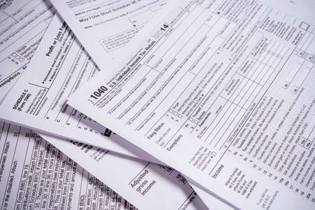 Foto per A variety of United States tax forms with a pencil - Immagine Royalty Free
