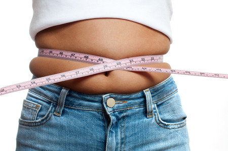 Photo for Overweight woman with tape measure around waist. Woman belly fat overweight - Royalty Free Image