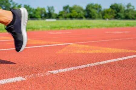 Photo for Close-up feet of woman running on track, runner on running lane - Royalty Free Image