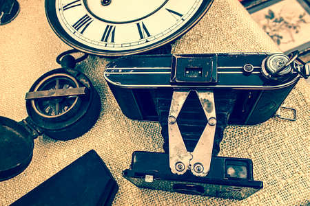 Old photo camera, clock and compass. Image digitally manipulated as one old photo.
