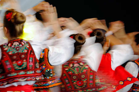 Photo for Abstract blur moving with amazing dance. Young Romanian dancers in traditional costume. - Royalty Free Image