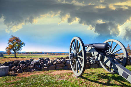 Photo for Civil war canon behind a stone wall on the Gettysburg battlefield in Autumn near sunset - Royalty Free Image