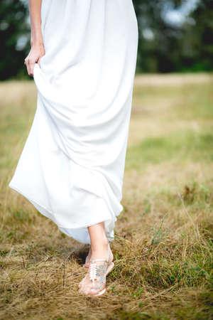 Beauty Romantic Girl Outdoors. Beautiful Model girl Dressed in Casual  Dress on the Field in Sun Light.