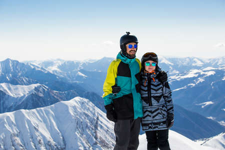 Couple in love snowboarder snowboarding on fresh white snow on ski slope on Sunny winter day