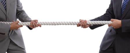 Photo for Two businessmen pulling tug of war with a rope concept for business competition, rivalry, challenge or dispute - Royalty Free Image