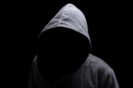 Photo pour Menacing silhouette of hooded man in the shadow - image libre de droit