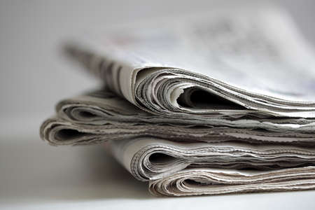 Photo pour Newspapers folded and stacked concept for global communications - image libre de droit