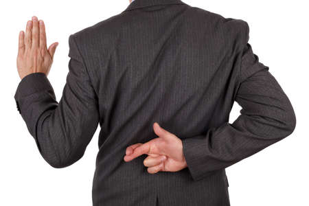 Photo pour Swearing an oath with fingers crossed behind back concept for dishonesty or business fraud - image libre de droit