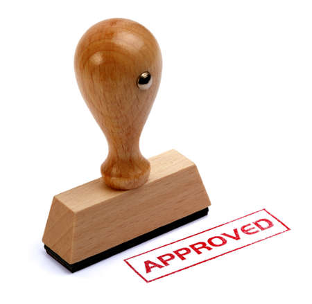 Photo pour Rubber stamper with the word APPROVED printed in red - image libre de droit