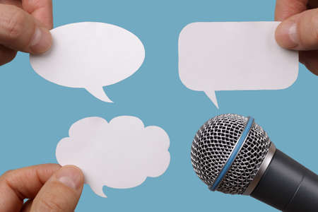 Photo for Conference, interview or social media concept with microphone and blank speech bubbles - Royalty Free Image