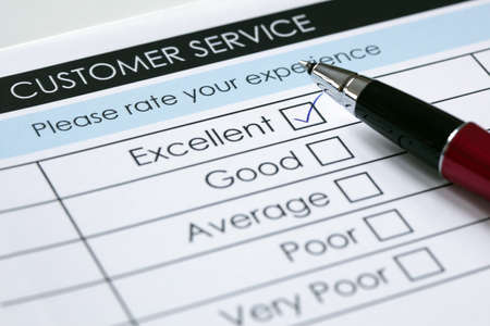 Photo pour Tick placed in excellent checkbox on customer service satisfaction survey form - image libre de droit