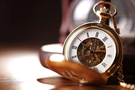 Photo pour Vintage pocket watch and hour glass or sand timer, symbols of time with copy space - image libre de droit