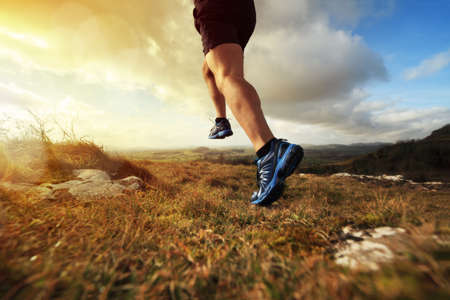 Photo pour Outdoor cross-country running in early sunrise concept for exercising, fitness and healthy lifestyle - image libre de droit