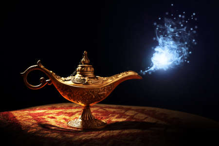 Photo pour Magic lamp from the story of Aladdin with Genie appearing in blue smoke concept for wishing, luck and magic - image libre de droit