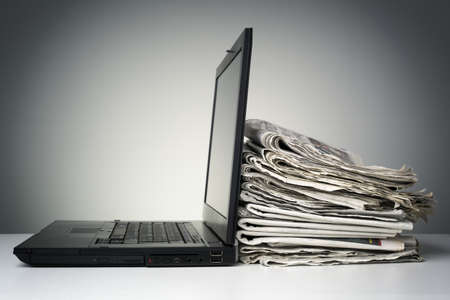 Photo for Laptop and newspaper concept for internet and electronic online news - Royalty Free Image