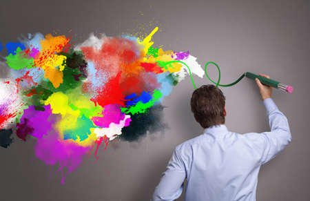 Photo pour Businessman painting abstract colorful design on gray background concept for  business creativity, imagination and inspiration - image libre de droit