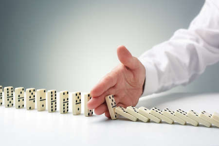 Photo pour Stopping the domino effect concept for business solution, strategy and successful intervention - image libre de droit