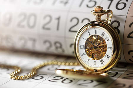 Photo pour Pocket watch against a calendar concept for planning or scheduling - image libre de droit