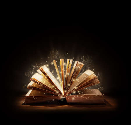 Photo pour The magic of reading, storytelling and education or bible and religion, Black backround space above for text message or copy. - image libre de droit