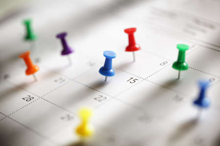 Photo for Thumbtack in calendar concept for busy, appointment and meeting reminder - Royalty Free Image