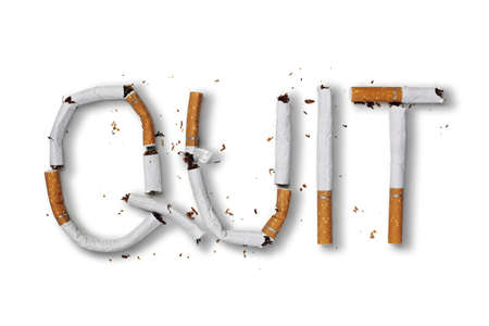 Photo pour Quit smoking word written with broken cigarette concept for quitting smoking - image libre de droit