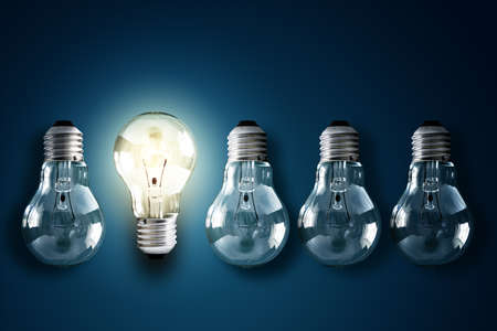 Photo for Illuminated light bulb in a row of dim ones concept for creativity, innovation and solution - Royalty Free Image
