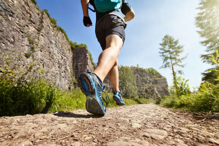 Photo pour Outdoor cross-country running in summer sunshine concept for exercising, fitness and healthy lifestyle - image libre de droit
