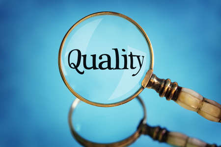 Photo pour Magnifying glass focus on word quality concept for quality control, customer satisfaction and excellence - image libre de droit
