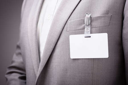 Foto de Businessman at an exhibition or conference wearing a blank security identity name card or tag - Imagen libre de derechos