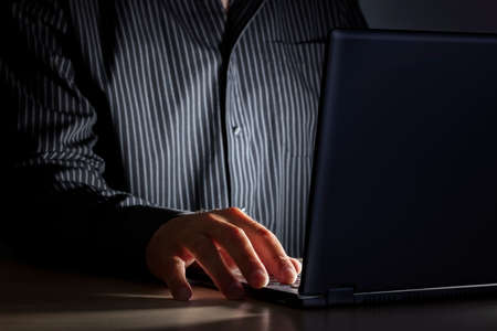 Photo pour Late night internet addiction or working late man using laptop at a desk in the dark - image libre de droit