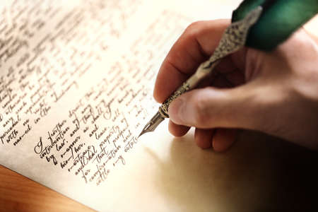 Foto de Writing with quill pen last will and testament or concept for law, legal issues or author - Imagen libre de derechos