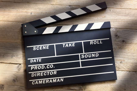 Photo for Film slate or movie clapper board on wood background - Royalty Free Image