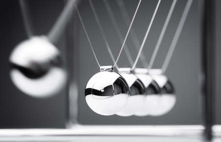 Photo pour Newton's cradle physics concept for action and reaction or cause and effect - image libre de droit