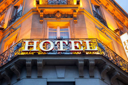 Photo for Illuminated hotel sign taken in Paris at night - Royalty Free Image