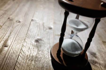 Photo pour Hourglass time passing concept for business deadline, urgency and running out of time - image libre de droit