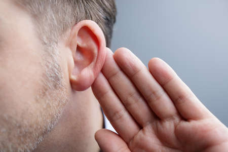 Photo pour Man with hand on ear listening for quiet sound or paying attention - image libre de droit