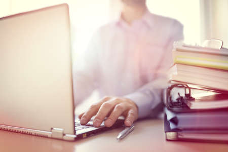 Foto de Businessman or designer using laptop computer at desk in office - Imagen libre de derechos